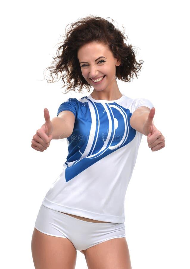 Ładny kobiety przedstawienia kciuk up podpisuje z oba rękami ono uśmiecha się w błękicie obraz royalty free