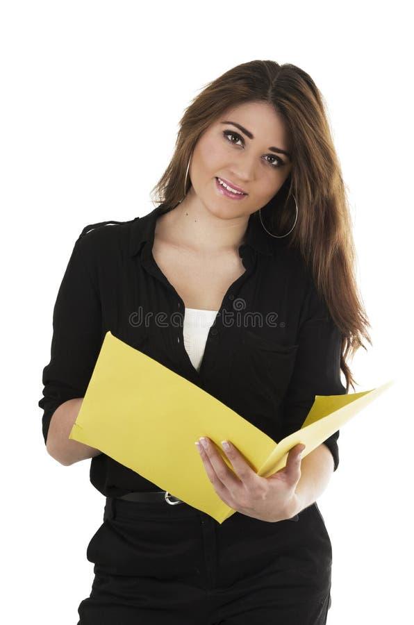 Ładny latynoski młody uczeń trzyma kolor żółtego obraz royalty free