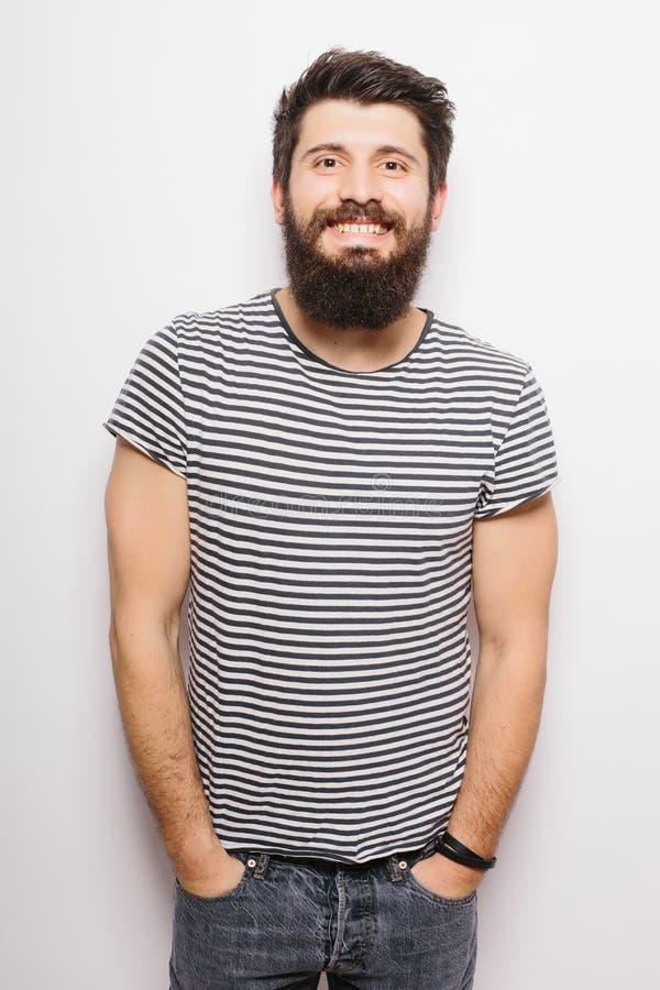 Ładny przystojny młody człowiek z broda folującym heigh zdjęcie royalty free