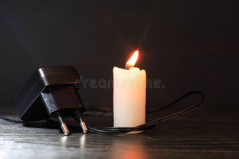 Ładowarka I świeczka fotografia stock