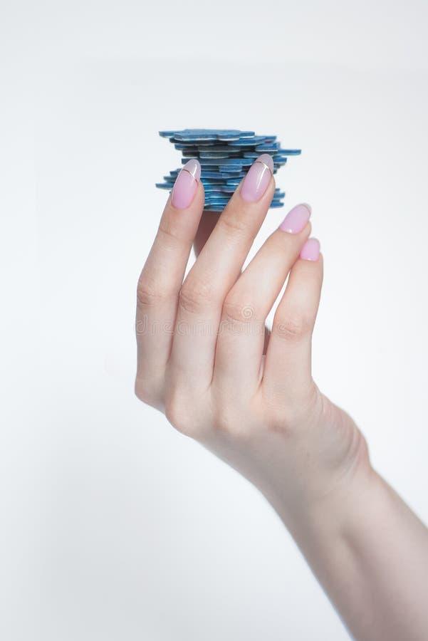Łamigłówki w ręce na bielu obraz stock