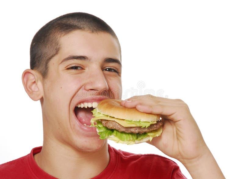 łasowanie hamburger obraz stock
