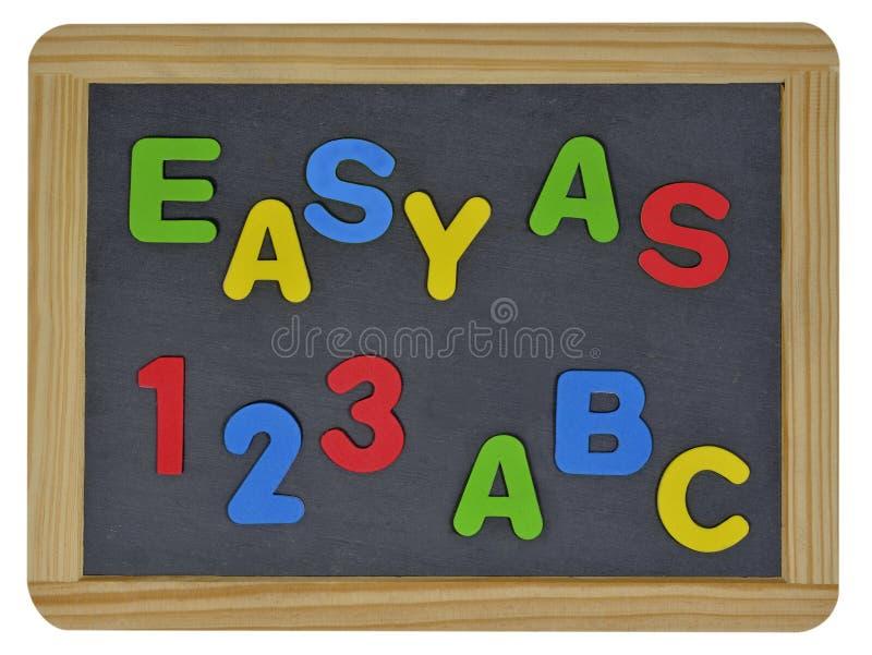 Łatwy jako 123 ABC w barwionych listach na łupku obrazy royalty free