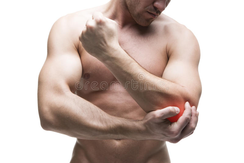 łokcia ból buck mięśni ciała Przystojny bodybuilder pozuje w studiu Odizolowywający na białym tle z czerwoną kropką zdjęcie stock
