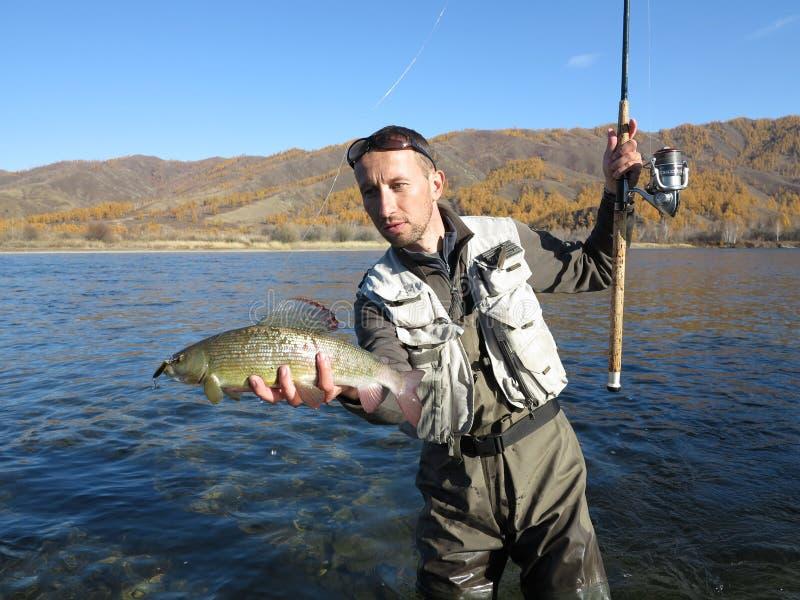 Łowić - lipnia połów w Mongolia obraz royalty free