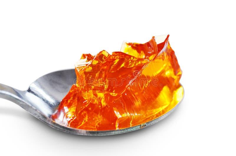 Łyżkowy pełny pomarańcze galareta zdjęcia royalty free