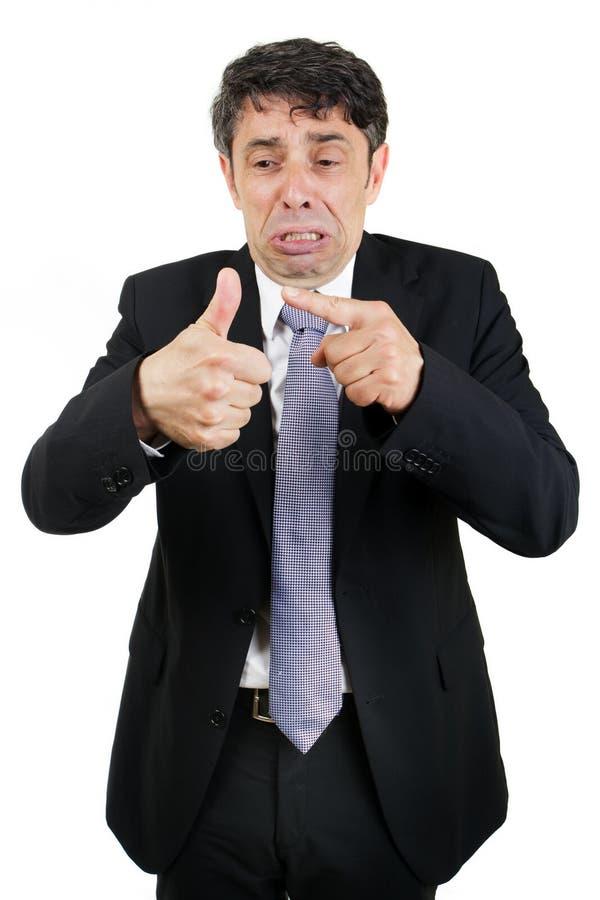 Łzawy mężczyzna wskazuje jego raniący obraz stock