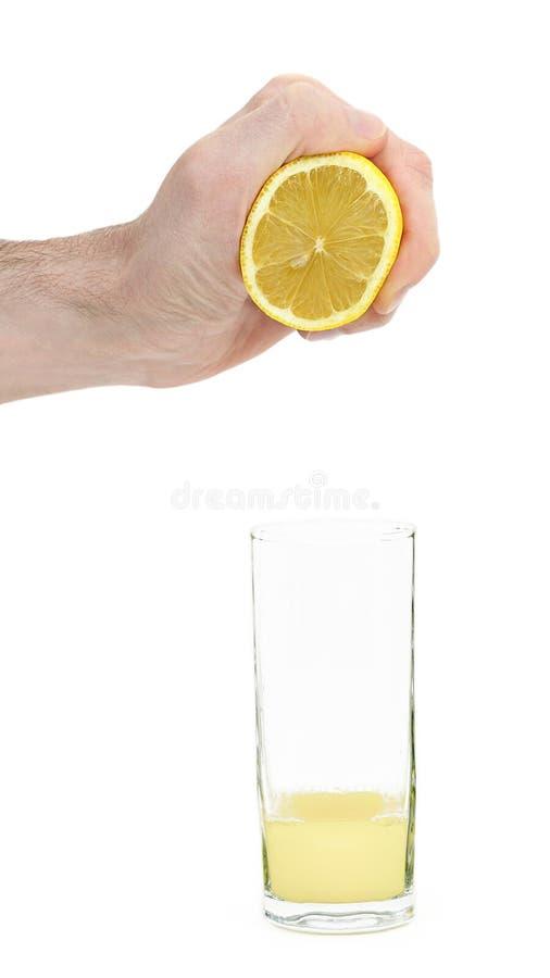 Ściśnięcie cytryny sok zdjęcie stock