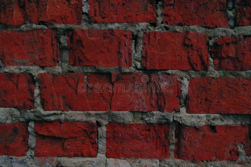 Ściana czerwień kamienia tło zdjęcia stock