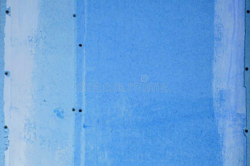 Ściana hardboard z śladami kleidło i farba fotografia stock