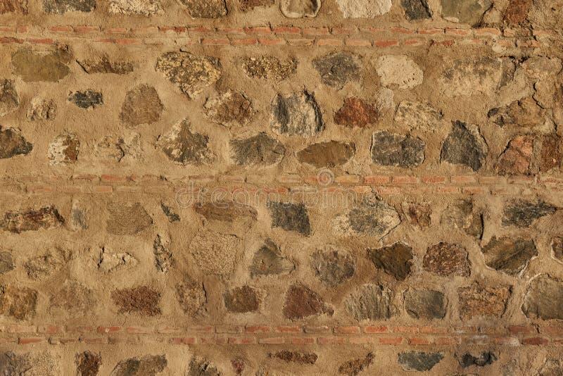 Ściana kamienie i brown cegły abstrakcyjny tło fotografia royalty free