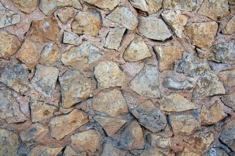 Ściana szorstcy popielaci ostrze kamienie obraz royalty free