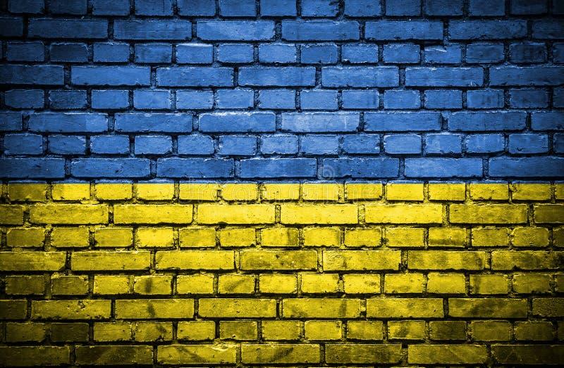 Ściana z cegieł z malującą flagą Ukraina ilustracji