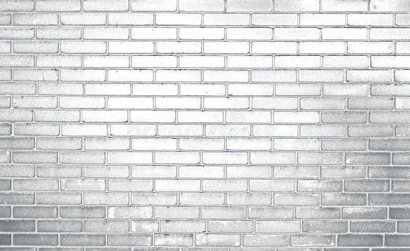 Ściana z cegieł, popielaty backgraund obrazy royalty free