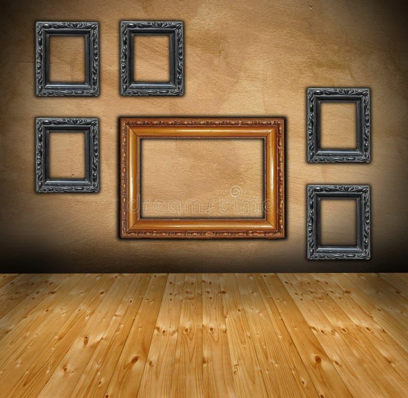 Ściana z składem puste ramy obrazy stock
