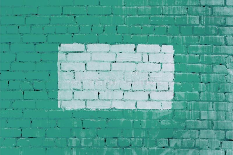 Ściana zielona cegła z białą ramą, Piękny tło Opróżnia miejsce dla inskrypcj fotografia royalty free
