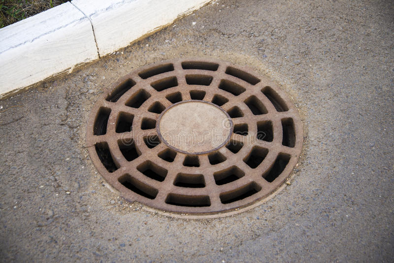 Ściekowa manhole pokrywa obraz royalty free