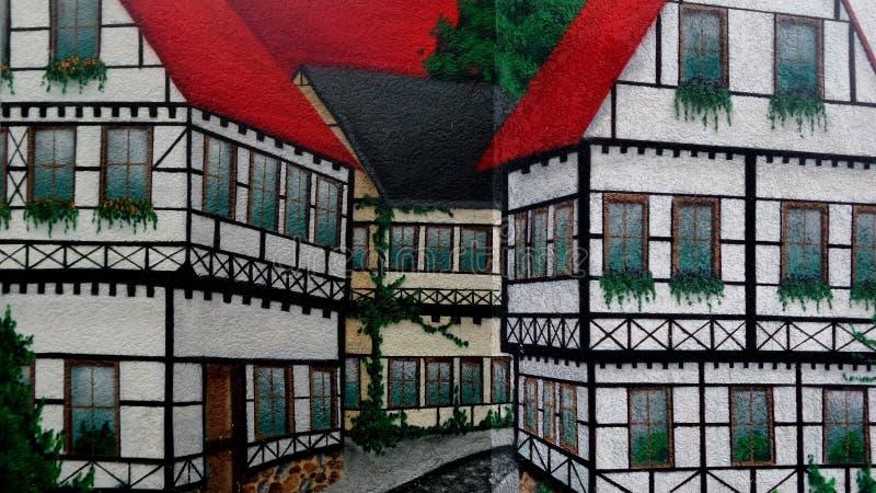 Ścienna farby sztuka połowa domów cembrujący obraz stock