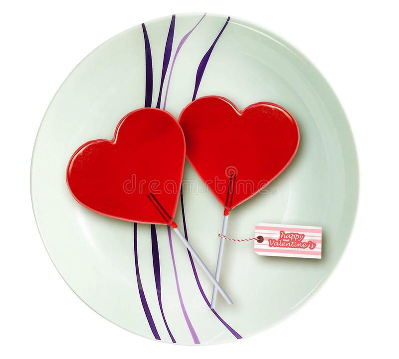 Ściennego papieru walentynek dnia kartka z pozdrowieniami z parą czerwoni kierowi kształtów lizaki wpólnie odizolowywający na now zdjęcia royalty free