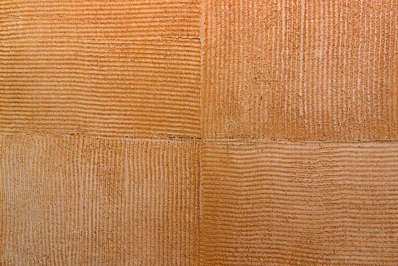 Ściennej tekstury brązu kwadrata farby Naciekowy pomarańczowy tło zdjęcie royalty free