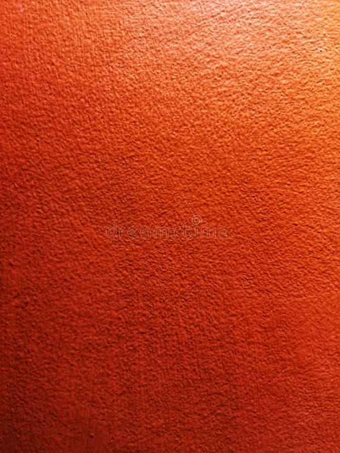 Ścienny cementowy czerwony pomarańczowy kolor szorstkiej powierzchni tekstury materiał fotografia stock