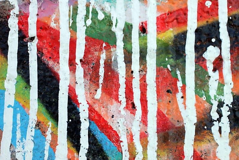 Ścienny zakończenie up graffiti tekstura z wibrującymi kolorami, obraz stock