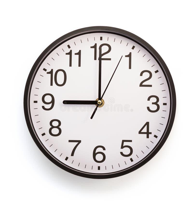 Ścienny zegar odizolowywający na bielu zdjęcie royalty free
