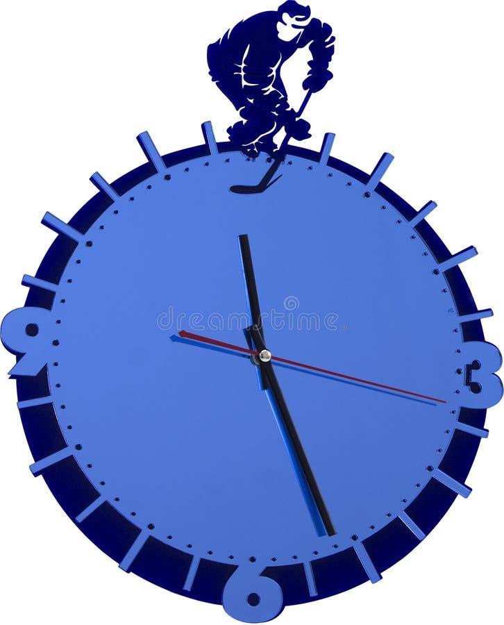 Ścienny zegar z gracz w hokeja odizolowywającym na bielu obrazy royalty free