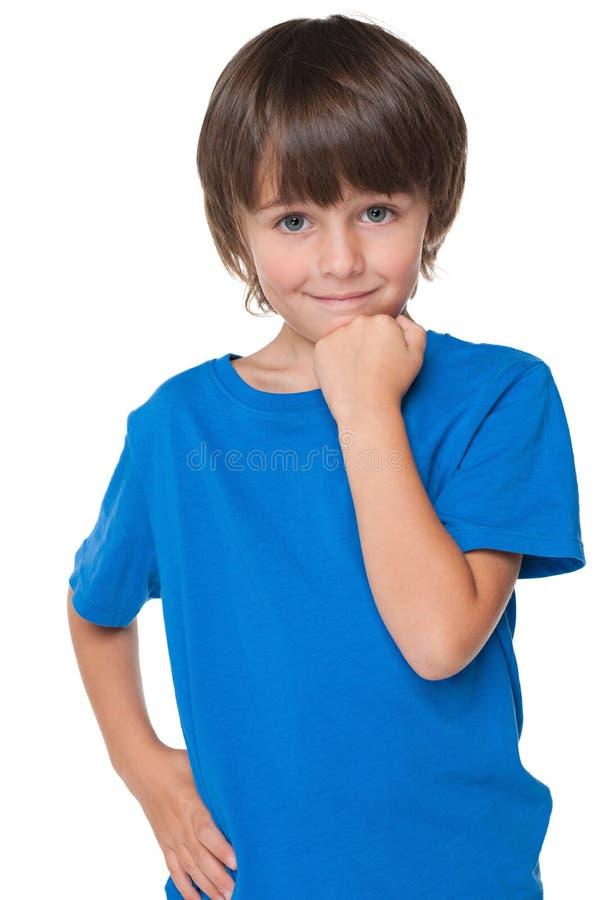Śliczna chłopiec w błękitnej koszula obrazy royalty free