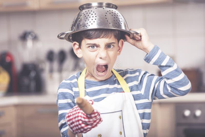 Śliczna chłopiec w kuchni fotografia royalty free