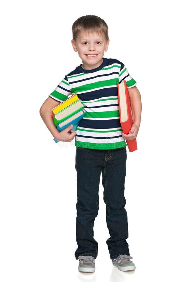 Śliczna chłopiec z książkami zdjęcie stock