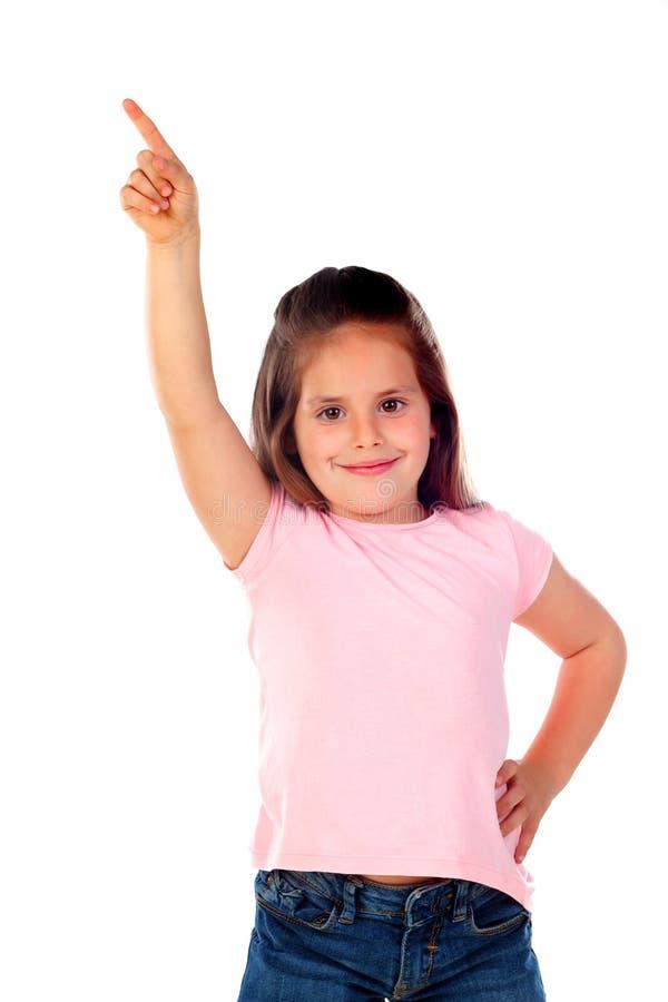 Śliczna dziecko dziewczyna wskazuje z jego palcem obrazy stock