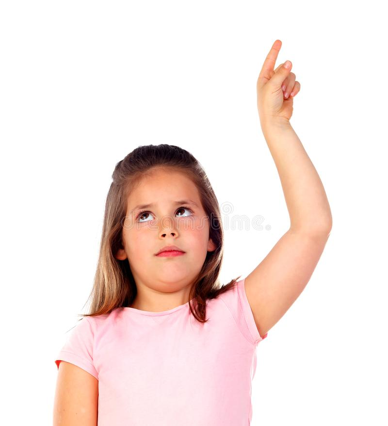 Śliczna dziecko dziewczyna wskazuje z jego palcem zdjęcia royalty free