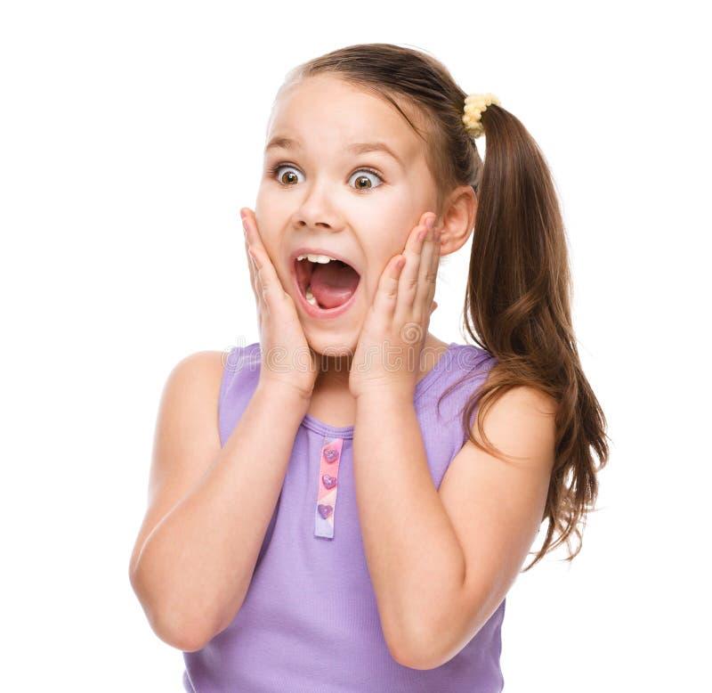 Śliczna dziewczyna trzyma jej twarz w zdziwieniu fotografia royalty free