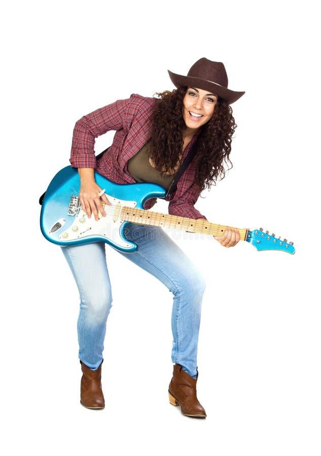 Śliczna kobieta Bawić się gitarę elektryczną zdjęcie royalty free
