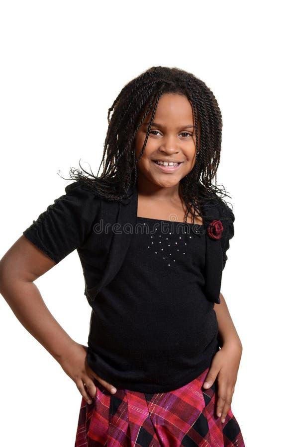 Śliczna mała dziewczynka jest ubranym w kratkę spódnicę zdjęcie royalty free