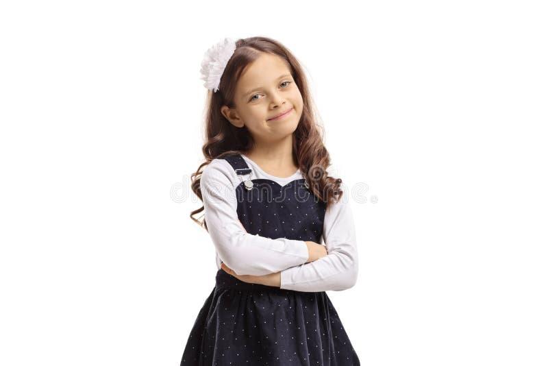 Śliczna mała dziewczynka ono uśmiecha się i pozuje obrazy royalty free
