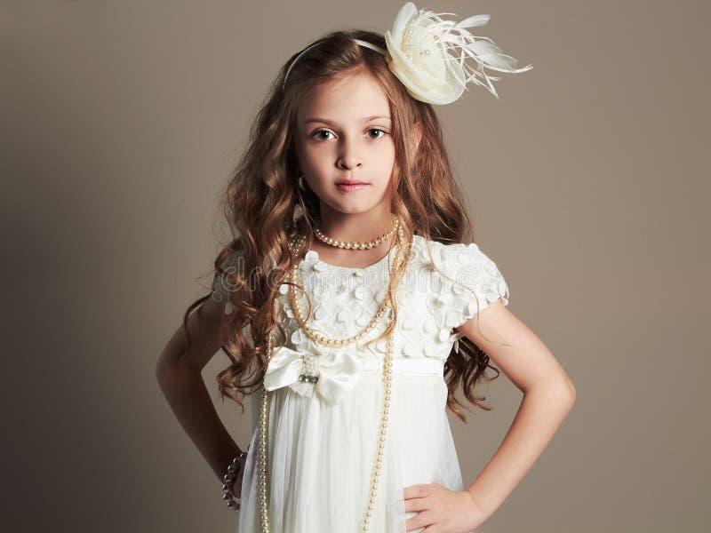 Śliczna mała dziewczynka w princess sukni Piękny dziecko obraz stock