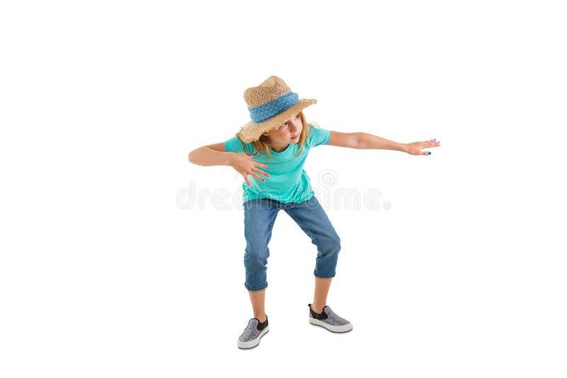 Śliczna modniś mała dziewczynka ćwiczy ona ruchy obraz stock