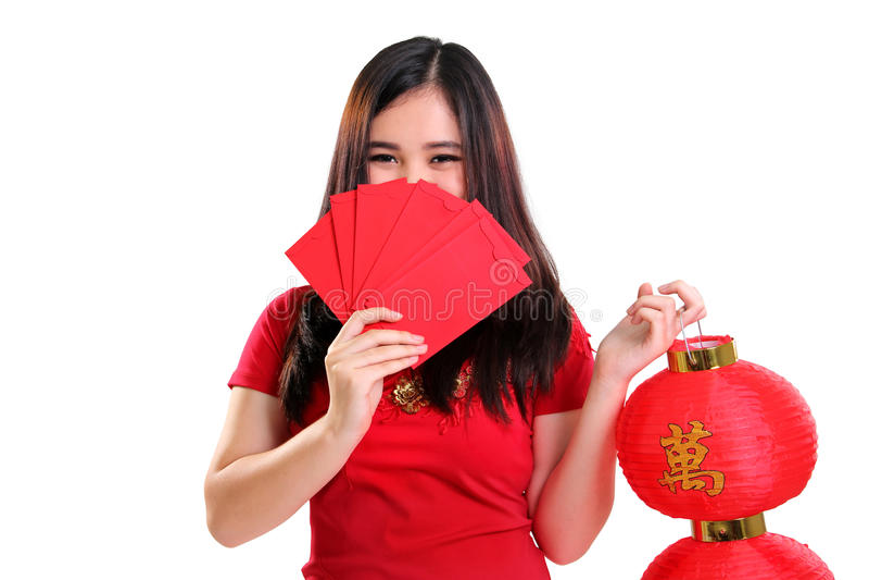 Śliczna nieśmiała dziewczyna w cheongsam sukni odizolowywającej zdjęcie royalty free