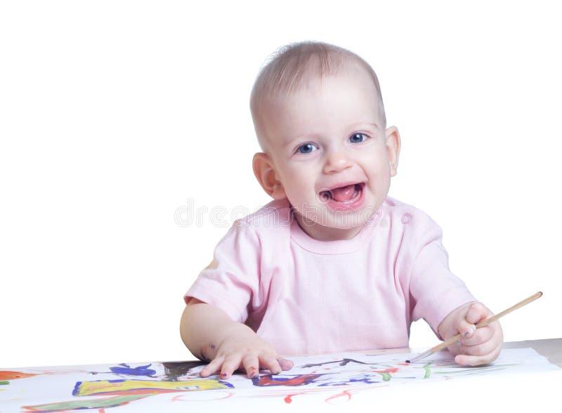 Śliczne dziewczynka remisów farby zdjęcia stock