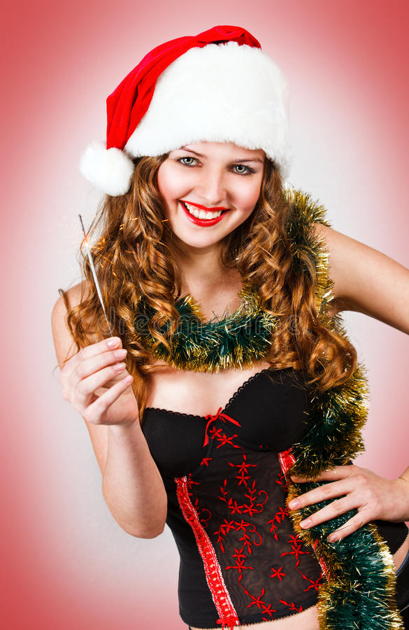 ślicznej dziewczyny kapeluszowi target388_1_ Santa sparklers obraz royalty free