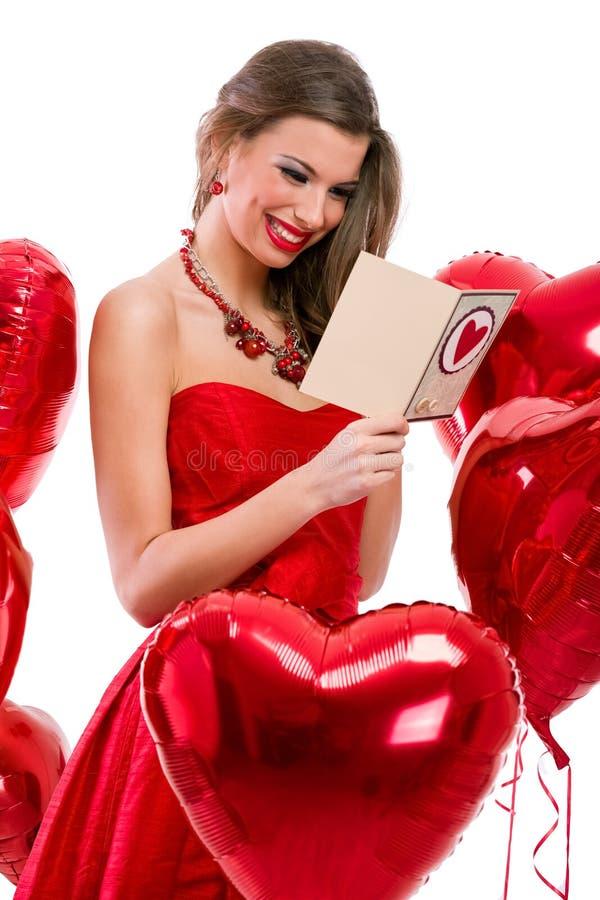 Ślicznej dziewczyny walentynki czytelnicza karta fotografia stock