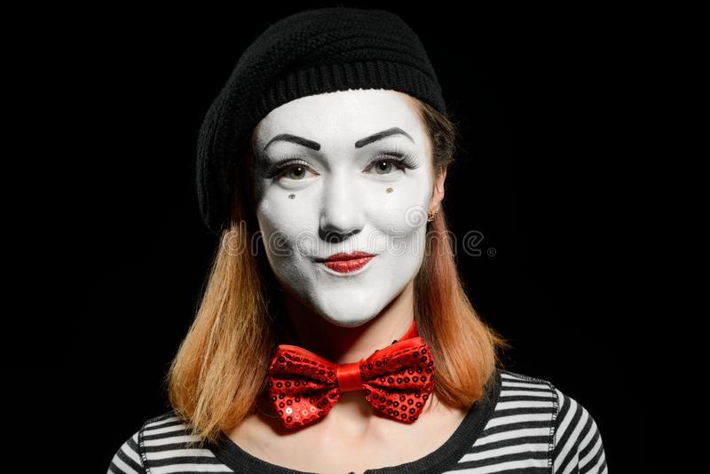 Śliczny żeński mim na czerni zdjęcia stock