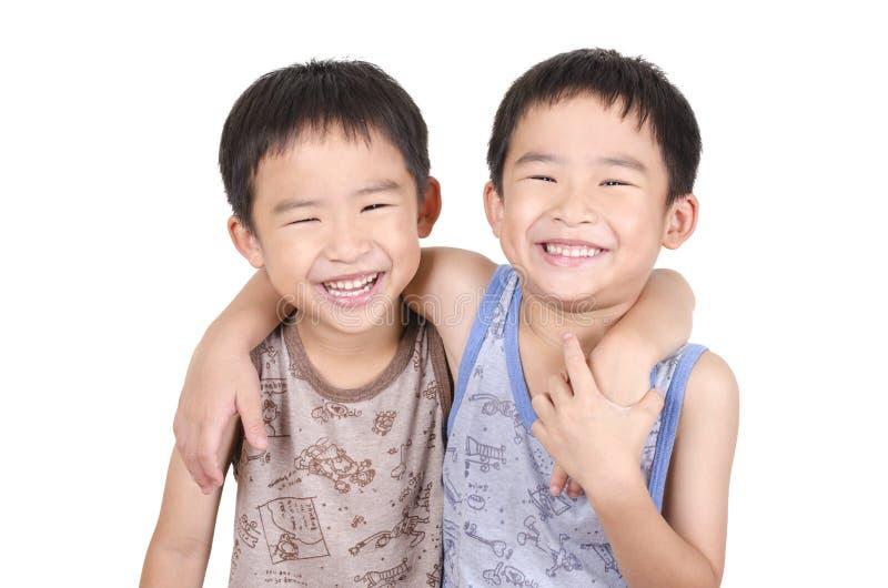 Śliczny bliźniaków ono uśmiecha się obrazy stock