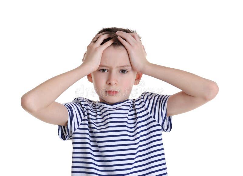Śliczny chłopiec cierpienie od migreny zdjęcie royalty free