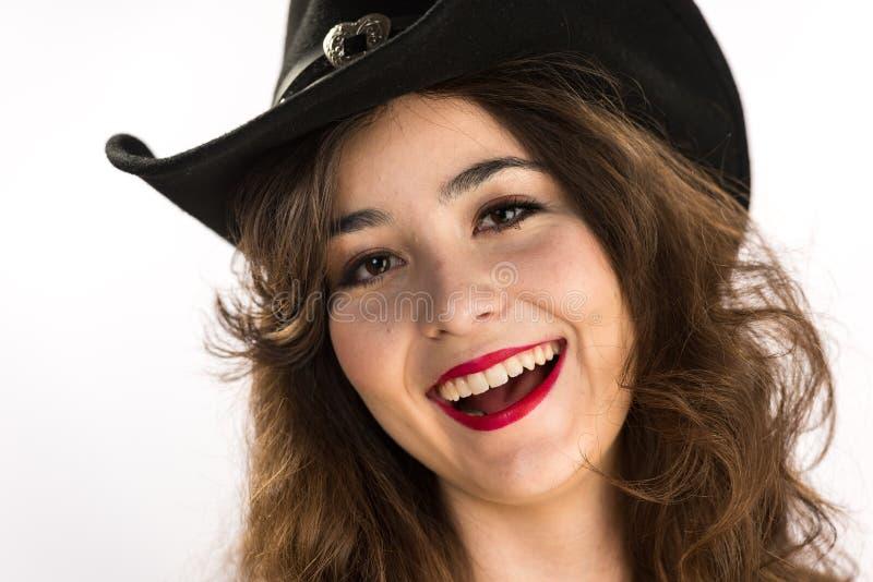 Śliczny Cowgirl w czarnym kapeluszu na Białym tle obraz stock