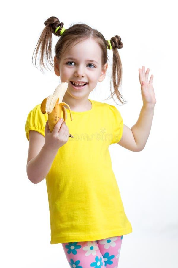 Śliczny dziecka łasowania banan Zdrowy karmowy łasowania pojęcie obraz royalty free