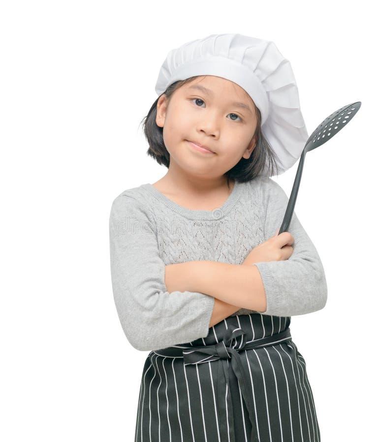 Śliczny dziewczyna szefa kuchni chwyta naczyń gotować odizolowywam zdjęcia royalty free