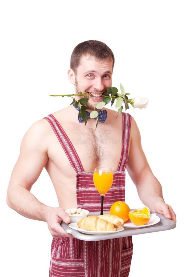 Śliczny młody człowiek trzyma tacę jedzenie zdjęcie stock